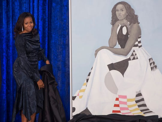 Former First Lady Michelle Obama unveils her portrait at the Smithsonian's National Portrait Gallery in Washington on Feb. 12, 2018.