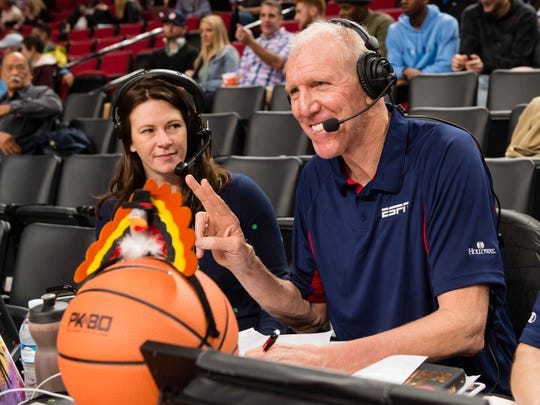 Bill Walton, right, ESPN sports broadcaster, works an NCAA college basketbll game between Portland and North Carolina at the Phil Knight Invitational tournament in Portland, Ore., Thursday, Nov. 23, 2017. (AP Photo/Troy Wayrynen)