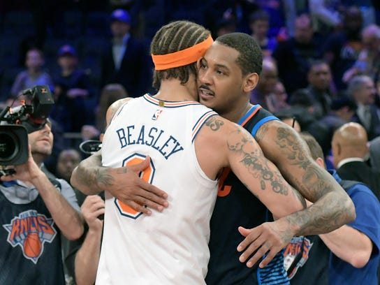 Oklahoma City Thunder forward Carmelo Anthony (7) and New York Knicks forward Michael Beasley (8) hug after an NBA basketball game Saturday, Dec.16, 2017, at Madison Square Garden in New York. The Knicks won 111-96. (AP Photo/Bill Kostroun)