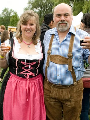ROBYN WISHNA/Contributed Annette and Frank White, of Lansing show off their Oktoberfest outfits that they bought in Germany. Thousands of beer lovers enjoyed 45 local, regional, and international breweries at the fourth annual Ithaca Brew Fest at Stewart Park.