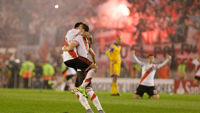 Leonel Vangioni, left, and Ramiro Funes Mori of Argentina's River Plate celebrate winning the Copa Libertadores final soccer match against Mexico's Tigres
