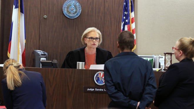 117th District Court Judge Sandra Watt oversees the arraignment of Alexis Derise Jr. on Monday, May 15. Derise is accused of hitting and killing cyclist and AEP Texas' communications director Andy Heines.