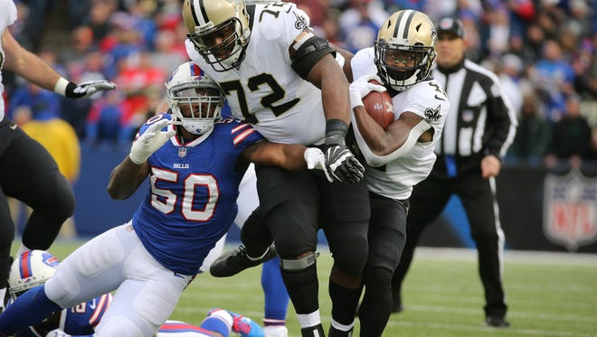 Saints running back Alvin Kamara (41)  follows a block by Terror Armstead (72) on Bills Ramon Humber. Tamara rushed for 106-yards and a touchdown in a 47-10 New Orleans win.