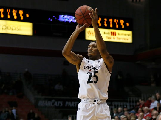 Cincinnati Bearcats guard Kevin Johnson (25) rises