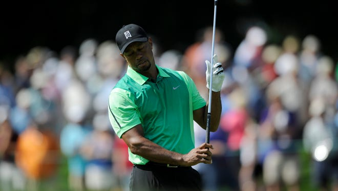 Tiger Woods reacts on the 17th fairway during the first round of the Quicken Loans National tournament on Thursday in Bethesda, Maryland.