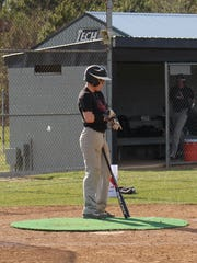 Sussex Tech senior Trey Banning prepares to take live batting practice.