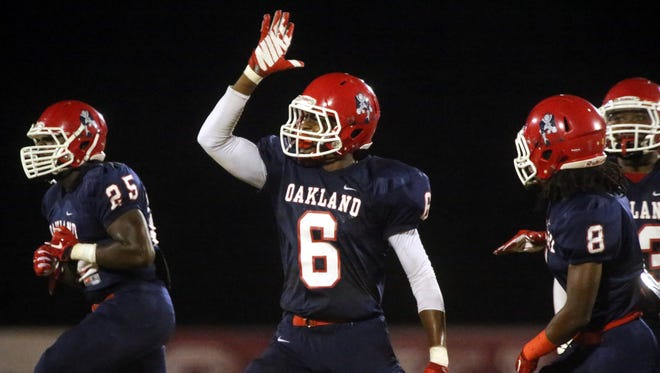 Oakland's Kaleb Oliver (6) celebrates making an interception during the game against Blackman  in 2015. Oliver committed to Mississippi State on Wednesday.