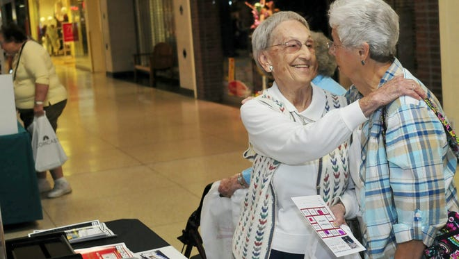 In this file photo, Esther Wagner, left, and Shirley Jones greet each other at the annual senior fair Friday, September 25, 2015 at Chambersburg Mall. The fair is sponsored by The Village of Laurel Run and hosted by Rep. Rob Kauffman.