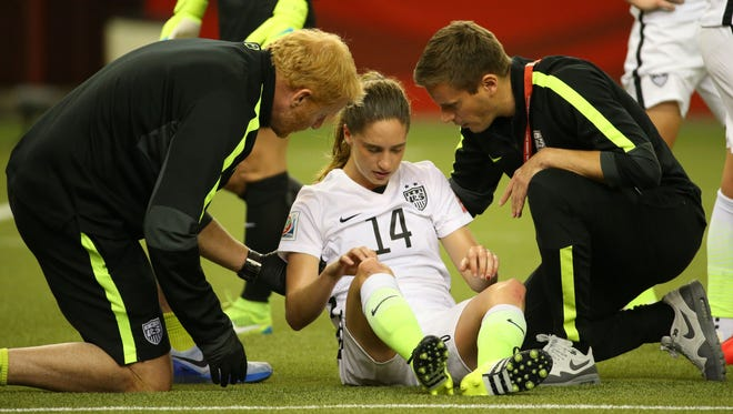 Jun 30, 2015; Montreal, Quebec, CAN; United States midfielder Morgan Brian (14) is tended to during the first half against Germany in the semifinals of the FIFA 2015 Women's World Cup at Olympic Stadium. Mandatory Credit: Jean-Yves Ahern-USA TODAY Sports