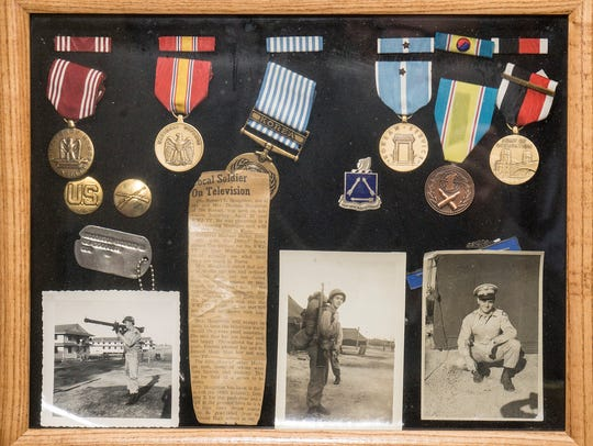 Robert Houghton displays medals and memorabilia from