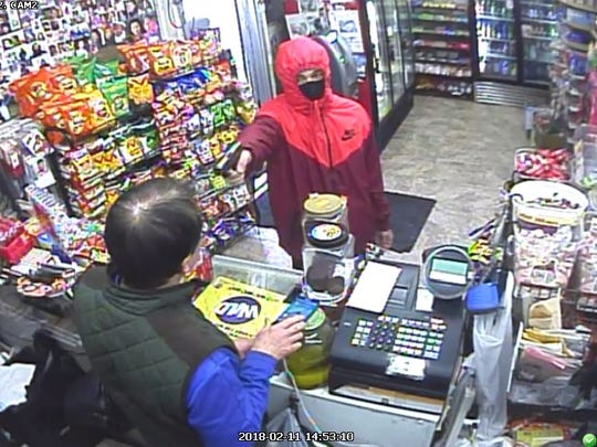 This is another photo of the armed suspect in the Lee's Market attempted robbery.