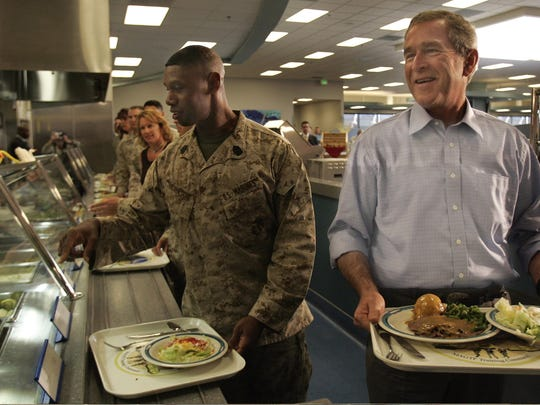 President George W. Bush prepares to have lunch after having been served on the chow line at the Marine Air Ground Task Force Training Command at Twentynine Palms.