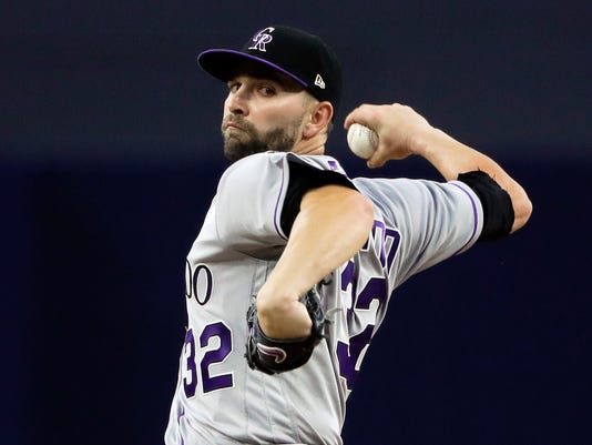 Colorado Rockies starting pitcher Tyler Chatwood pitches to a San Diego Padres batter during the first inning of a baseball game, Tuesday, May 2, 2017, in San Diego. (AP Photo/Gregory Bull)