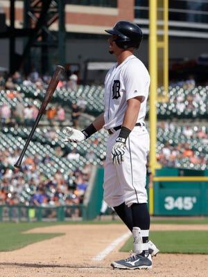 Tigers catcher James McCann flips his bat after striking out to end the ninth inning of the Tigers' 6-4 loss to the Twins on Sunday, Aug. 13, 2017, at Comerica Park.