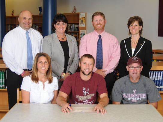 Jerrin Toomey-Football-Bloomsburg University Front row, from left: Mrs. Michelle Toomey, Jerrin Toomey, Mr. Chad Toomey; back row, from left: coach Ron Miller, Ms. Janet May, High School Principal, Roger Czerwinski, Athletic Director and Dr. Emilie Lonardi, Superintendent.
