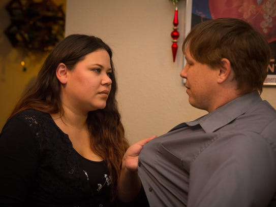 Monica Garcia-Alley seems upset with her husband of