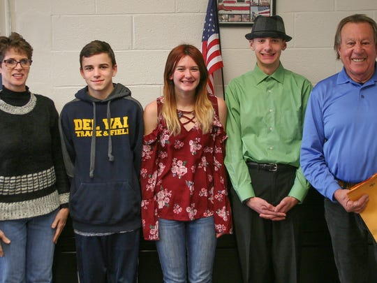 Checks and certificates are awarded to Voice of Democracy essay contest winners at Delaware Valley High School on Dec. 13. Here are from left: VFW Auxiliary President Anne Pyne; Bryce Blankenship, third place, Samantha Ruby, first place, Kyle Reers, second place, and VFW Commander Sonny Silva.