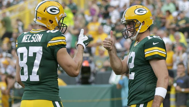 Green Bay Packers' Jordy Nelson and Aaron Rodgers have fun prior to the start of Friday's game.