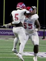Hirschi's Daimarqua Foster celebrates a touchdown with
