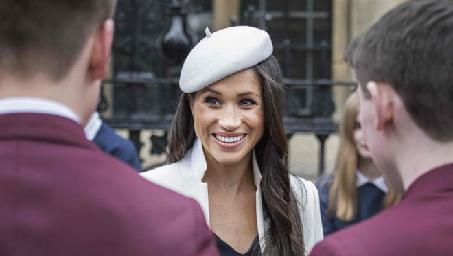 Meghan Markle is all smiles at a reception in central London.