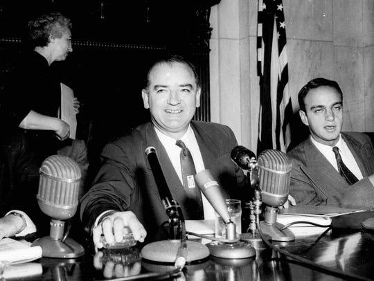 Roy Cohn, right, as Sen. Joe McCarthy, R-Wis., presides