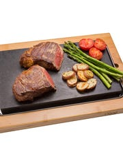 The Steak Stone Serving Set is perfect for placing meats, fish and vegetables in the oven. Price: $79.95.