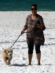 Denise Andrews and her dog, Sunny, take a walk at the