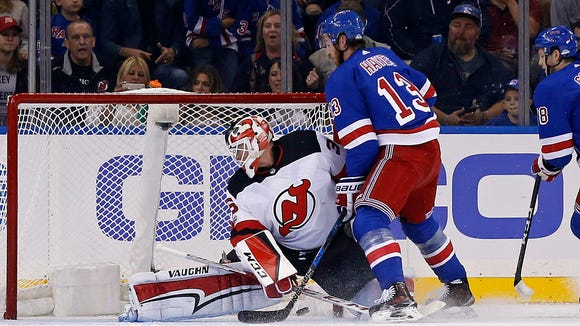 New York Rangers right wing Kevin Hayes (13) scores a goal past New Jersey Devils goalie Cory Schneider during the first period of an NHL preseason hockey game Wednesday, Sept. 20, 2017, in New York. (AP Photo/Adam Hunger)