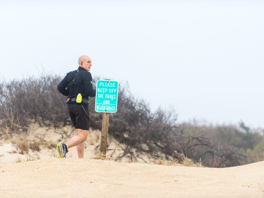 Phil King begins his cross country run from Cape Henlopen