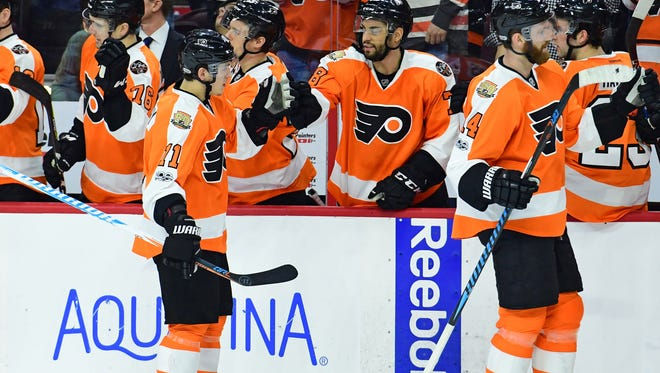 Flyers center Travis Konecny (11) celebrates his goal against the Vancouver Canucks during the first period.