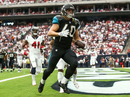 Jacksonville Jaguars running back Tommy Bohanon (40) makes a touchdown reception during the third quarter against the Houston Texans at NRG Stadium.