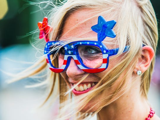 "July 3, 2017 - Heather Walker, of Drummonds, TN, shows off her patriotic frames during the annual Flag City Celebration at USA Stadium in Millington on Monday. ""I just have to sport them to celebrate our freedom and Independence Day,"" Walker said. ""I just want everybody to be proud to be an American."""