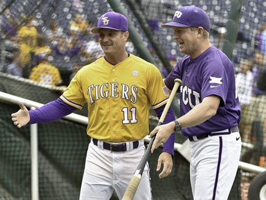TCU coach Jim Schlossnagle, right, jokes with LSU's hitting coach Andy Cannizaro (11) during team practice at TD Ameritrade Park in Omaha, Neb., Friday.