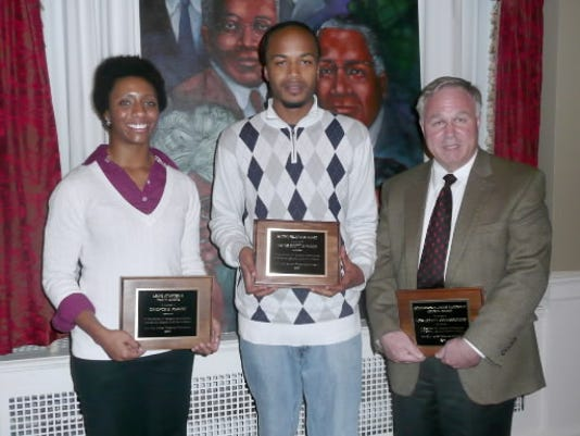 Wayne Scott, center, is shown here in 2011 accepting the Human Relation Commission awards during the 30th Annual Dr. Frederick Holiday Celebration.