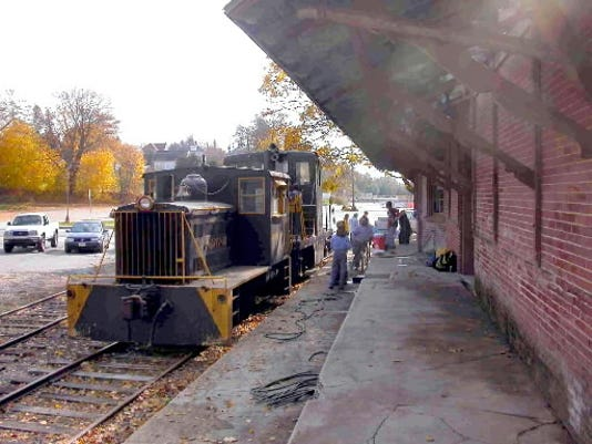 Crews and volunteers have been working to repair the buildings, track and locomotives of the Stewartstown Railroad. This submitted photo was taken a few years ago when Boy Scouts from Troop 205 helped with a cleanup. The troop serves the area between Stewartstown and New Freedom. (SUBMITTED)
