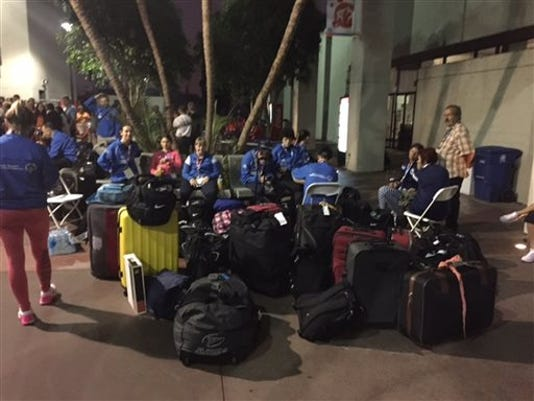 This photo provided by KNX1070 Newsradio shows Special Olympics competitors with their baggage after sleeping on the gymnasium floor at Loyola Marymount University in Los Angeles early Wednesday, July 22, 2015.