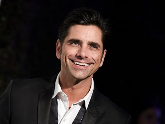 FILE - In this Feb. 22, 2015 file photo, John Stamos arrives at the 87th Academy Awards - 2015 Elton John AIDS Foundation Oscar Party in West Hollywood, Calif.