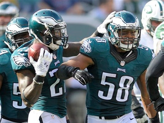 Philadelphia Eagles outside linebacker Jordan Hicks (58) celebrates with teammates after intercepting a pass by the New York Jets during the fourth quarter on Sunday in East Rutherford, N.J.