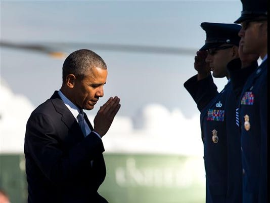 President Barack Obama returns a salute prior to boarding Air Force One before his departure from Andrews Air Force Base, Md. Obama will keep 5,500 U.S. troops in Afghanistan when he leaves office in 2017, according to senior administration officials, casting aside his promise to end the war on his watch and instead ensuring he hands the conflict off to his successor.