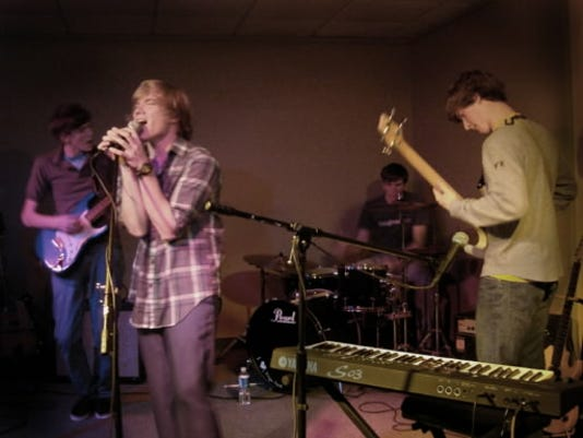 Descartes robbers Ergo Sum rock out at their CD release party Nov. 18 at York College. The disc,  Dead Horse Morse Code,  can be picked up at their shows. From left to right: David Imhoff, Thomas Howard, Patrick Maloney, Jeffrey Mleczko.