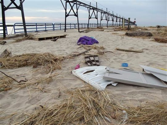 In this Monday, Nov. 3, 2014 photo, debris is pictured along the pier at Tiscornia Beach in St. Joseph, Mich., after an Oct. 31st storm swept across the Midwest.