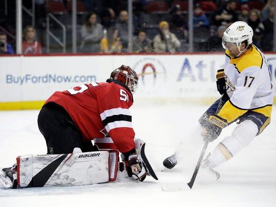 New Jersey Devils goalie Ken Appleby (55) traps the puck as Nashville Predators left wing Scott Hartnell (17) attacks during the first period of an NHL hockey game, Thursday, Jan. 25, 2018, in Newark, N.J.