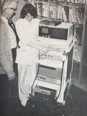 Dr. Jerry McKenney, left, chief of staff at Union County Hospital, prepared the hospital's new ultrasound machine with the help of Lisa Riggins, RTT in March 1984.