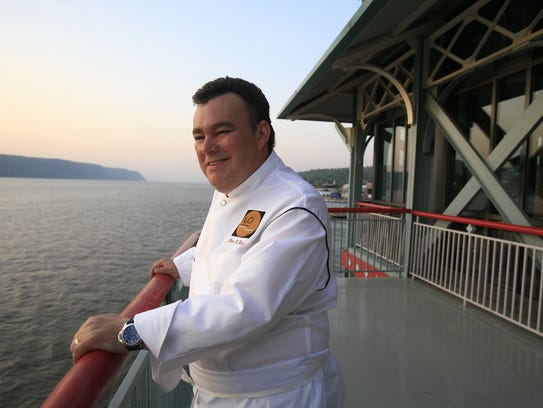 Chef Peter X. Kelly, stands on the outdoor deck of