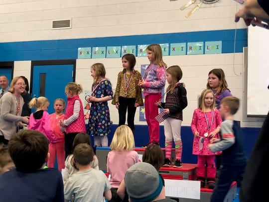 First-graders participate in a medal ceremony at Riverside