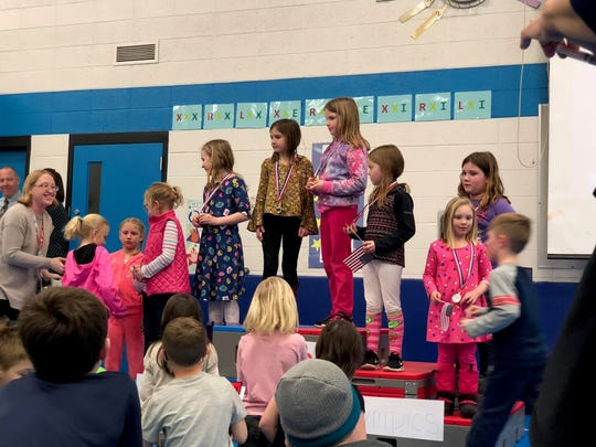 First-graders participate in a medal ceremony at Riverside Elementary's Math Olympics.