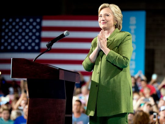 Hillary Clinton reacts to applause as she speaks at