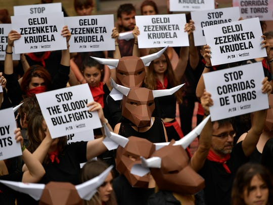 Demonstrators protest against bullfighting in front