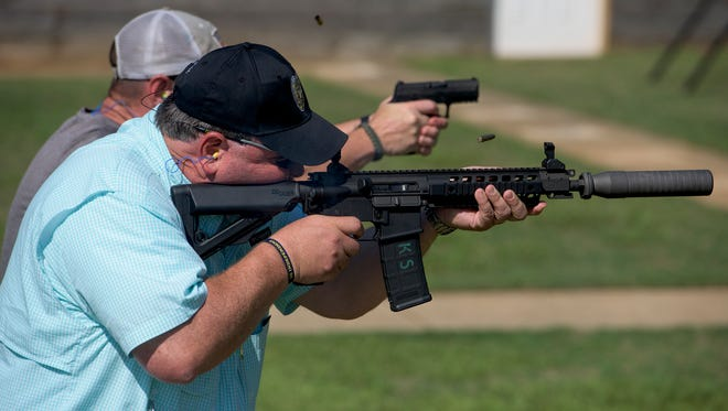 Law enforcement officers test fire as the Prattville Police Department hosts a law enforcement arms vendors expo at the police shooting range in Prattville, Ala., on Wednesday June 22, 2016.