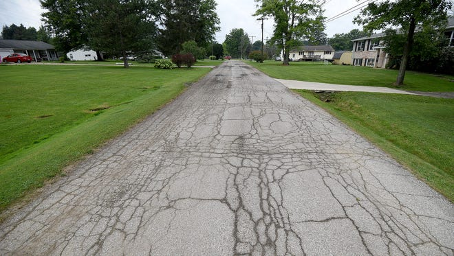 Residents of the short dead-end section of Timber Road are upset that the stretch was not included in a summer resurfacing project.